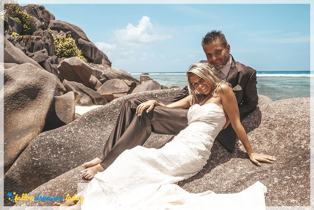 Loving bride and groom posing at the sea.