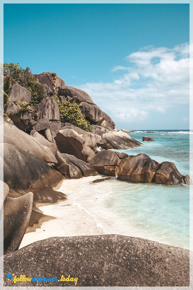 Large boulders and palm trees along a  best beaches in the world