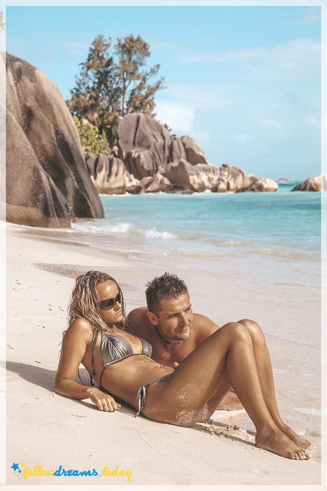 Young couple enjoying the beach - la Digue, Seychelles