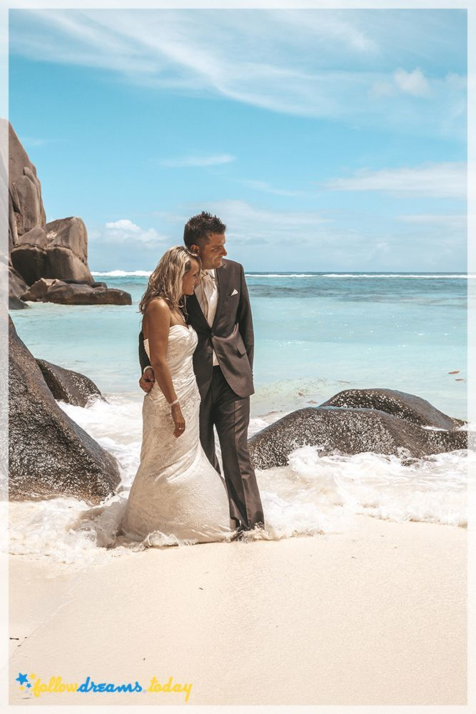 Romantic couple relaxing at the beautiful seychelles beach during their honeymoon
